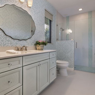 Design ideas for a medium sized traditional family bathroom in Miami with freestanding cabinets, green cabinets, an alcove shower, a one-piece toilet, white tiles, ceramic tiles, green walls, porcelain flooring, a submerged sink and engineered stone worktops.
