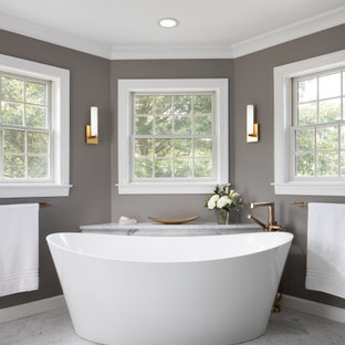 Example of a huge transitional master gray tile and marble tile marble floor, gray floor and single-sink bathroom design in Other with recessed-panel cabinets, dark wood cabinets, a two-piece toilet, gray walls, an undermount sink, granite countertops, white countertops and a freestanding vanity