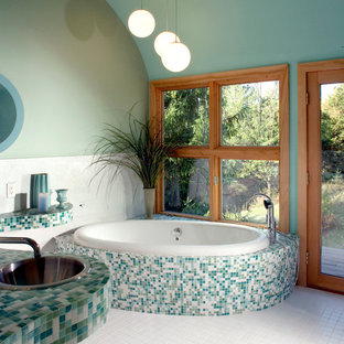 Design ideas for a modern bathroom in Milwaukee with mosaic tile and turquoise benchtops.