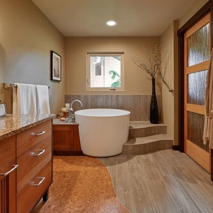 Photo of a large asian master bathroom in Portland with a japanese tub, multi-coloured tile, ceramic tile, cork floors, an undermount sink and engineered quartz benchtops.
