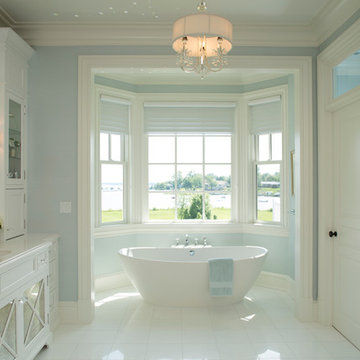 Tranquil spa bathroom with water views