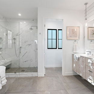 Inspiration for a transitional master gray tile and white tile gray floor bathroom remodel in San Francisco with flat-panel cabinets, light wood cabinets, white walls, an undermount sink, a hinged shower door and white countertops