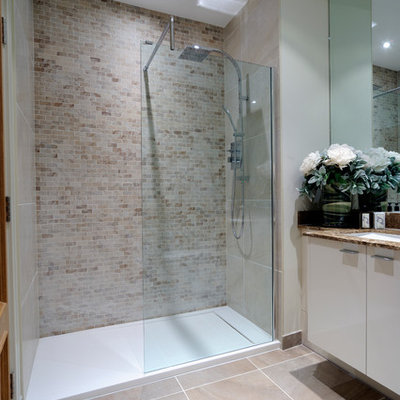 Inspiration for a transitional beige tile and subway tile alcove shower remodel in London with an undermount sink and flat-panel cabinets