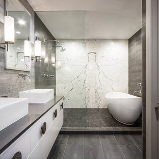 Inspiration for a transitional master gray tile gray floor bathroom remodel in Other with flat-panel cabinets, white cabinets, a vessel sink and gray countertops