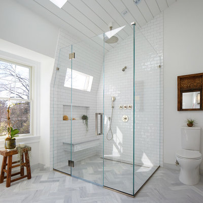 Corner shower - large transitional master white tile and subway tile gray floor and marble floor corner shower idea in New York with a two-piece toilet, white walls, a pedestal sink, flat-panel cabinets, gray cabinets and marble countertops