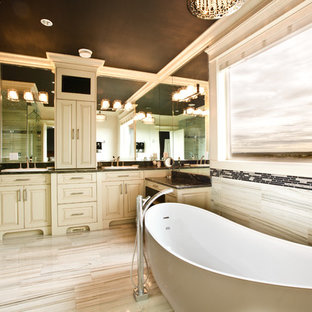 Inspiration for a large contemporary master multicolored tile and porcelain tile marble floor bathroom remodel in Vancouver with a vessel sink, raised-panel cabinets, light wood cabinets, granite countertops, a one-piece toilet and black walls