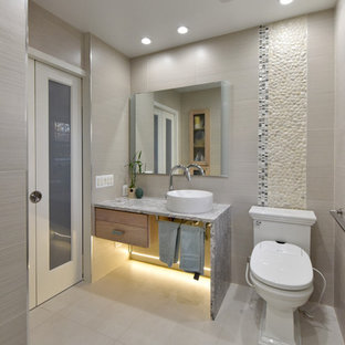 Inspiration for a transitional beige tile, black and white tile and pebble tile gray floor bathroom remodel in DC Metro with open cabinets, beige walls and a vessel sink