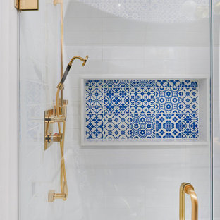 Transitional blue tile and white tile bathroom photo in Toronto with white walls and a hinged shower door
