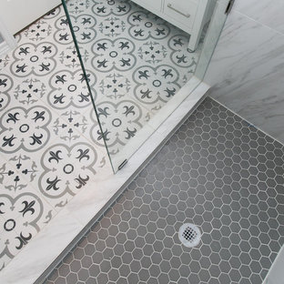 Inspiration for a small contemporary 3/4 gray tile, white tile and porcelain tile cement tile floor and multicolored floor corner shower remodel in Dallas with shaker cabinets, white cabinets, gray walls, an undermount sink, marble countertops, a hinged shower door and gray countertops