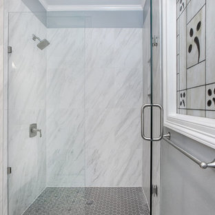 Corner shower - small contemporary 3/4 gray tile, white tile and porcelain tile cement tile floor and multicolored floor corner shower idea in Dallas with shaker cabinets, white cabinets, gray walls, an undermount sink, marble countertops, a hinged shower door and gray countertops