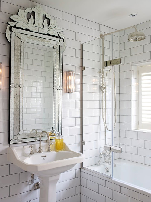 Inspiration For A Transitional White Tile And Subway Tub Shower Combo Remodel In London