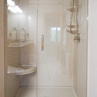 Diseño de cuarto de baño con ducha, tradicional renovado, de tamaño medio, con armarios con paneles con relieve, puertas de armario de madera oscura, bidé, baldosas y/o azulejos beige, baldosas y/o azulejos marrones, baldosas y/o azulejos grises, baldosas y/o azulejos multicolor, azulejos en listel, paredes grises, suelo de pizarra, lavabo bajoencimera, encimera de granito y ducha empotrada