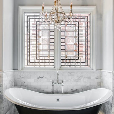 Inspiration for a mid-sized timeless master black and white tile and white tile mosaic tile floor and multicolored floor claw-foot bathtub remodel in Charlotte with white cabinets, gray walls, a one-piece toilet, a vessel sink, marble countertops and recessed-panel cabinets