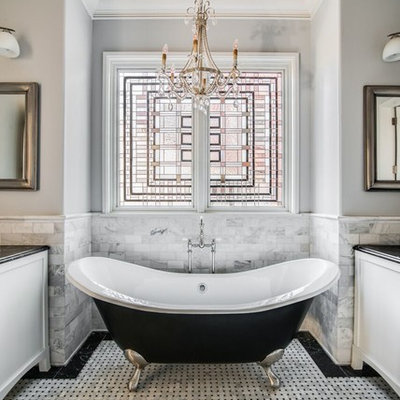 Claw-foot bathtub - mid-sized traditional master black and white tile and white tile mosaic tile floor and multicolored floor claw-foot bathtub idea in Charlotte with white cabinets, gray walls, a one-piece toilet, a vessel sink, marble countertops and recessed-panel cabinets