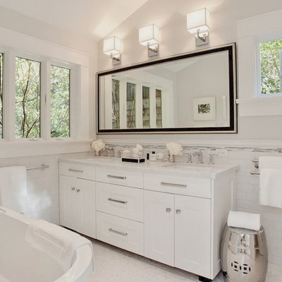 Transitional white tile and subway tile freestanding bathtub photo in San Francisco with an undermount sink, white cabinets, marble countertops and shaker cabinets