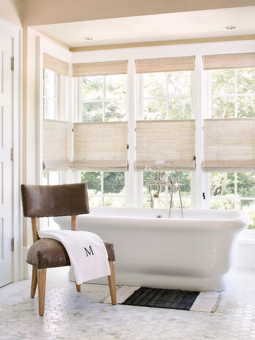 Inspiration For A Large Transitional Bathroom Remodel In Miami With A  Freestanding Tub And Beige Walls