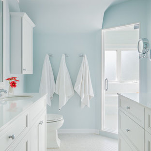 Example of a mid-sized transitional kids' white tile and glass tile marble floor alcove shower design in Chicago with an undermount sink, beaded inset cabinets, white cabinets, quartzite countertops, a one-piece toilet and blue walls