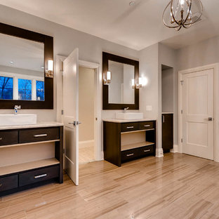 Large transitional master beige floor bathroom photo in Baltimore with furniture-like cabinets, dark wood cabinets, a one-piece toilet, gray walls and a vessel sink