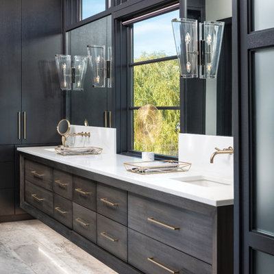 Bathroom - contemporary white floor bathroom idea in Other with flat-panel cabinets, gray cabinets, white walls, an undermount sink and white countertops