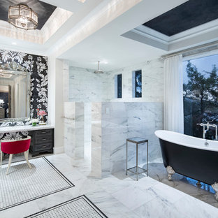 Inspiration for a huge mediterranean master black and white tile and marble tile white floor and marble floor bathroom remodel in Austin with raised-panel cabinets, black cabinets, white walls, white countertops, an undermount sink and marble countertops