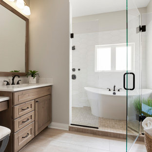 Bathroom - large transitional master white tile light wood floor and beige floor bathroom idea in Minneapolis with beaded inset cabinets, medium tone wood cabinets, gray walls, an undermount sink, a hinged shower door and white countertops