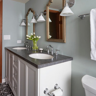 Example of a mid-sized transitional white tile and subway tile mosaic tile floor bathroom design in Chicago with shaker cabinets, white cabinets, a two-piece toilet, blue walls, an undermount sink and solid surface countertops