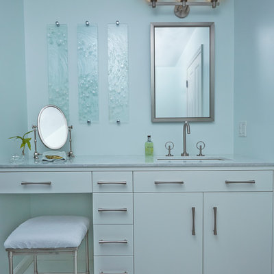 Inspiration for a mid-sized transitional blue tile and glass tile bathroom remodel in New York with an undermount sink, flat-panel cabinets, white cabinets, blue walls and marble countertops