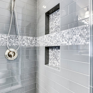 Example of a small transitional master ceramic floor bathroom design in DC Metro with raised-panel cabinets, an undermount sink, quartz countertops and a hinged shower door