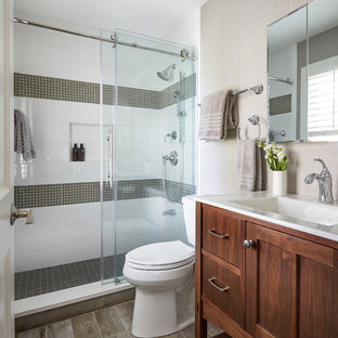 Bathroom - small transitional master white tile and ceramic tile porcelain floor and brown floor bathroom idea in Chicago with a two-piece toilet, beige walls, an integrated sink, white countertops, furniture-like cabinets and dark wood cabinets
