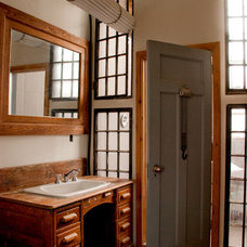 rustic bathroom by Lucid Interior Design Inc.