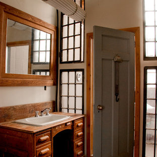 Bathroom - rustic bathroom idea in Toronto with wood countertops