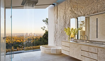 Travertine bathroom in Michael Bay home in Los Angeles