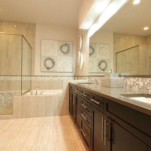 Imagen de cuarto de baño principal, tradicional renovado, de tamaño medio, con puertas de armario de madera en tonos medios, encimera de cuarcita, bañera esquinera, ducha esquinera, baldosas y/o azulejos beige, paredes beige, lavabo bajoencimera, armarios estilo shaker, baldosas y/o azulejos en mosaico y ducha con puerta con bisagras