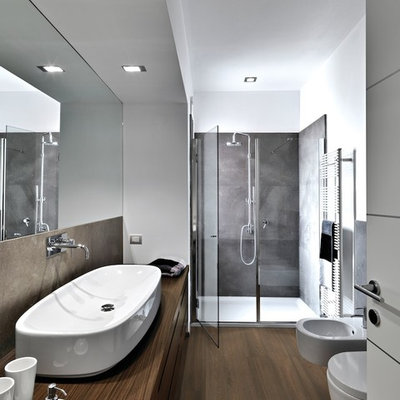 Mid-sized minimalist master vinyl floor alcove shower photo in Philadelphia with flat-panel cabinets, medium tone wood cabinets, a bidet, white walls, a trough sink and wood countertops