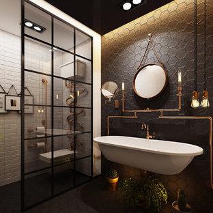 Ispirazione per una stanza da bagno con doccia industriale con piastrelle nere, piastrelle di cemento, pareti nere, pavimento in cementine, lavabo sospeso e pavimento nero
