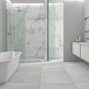 Example of a large trendy master porcelain tile porcelain tile and double-sink bathroom design in Orange County with solid surface countertops and a floating vanity