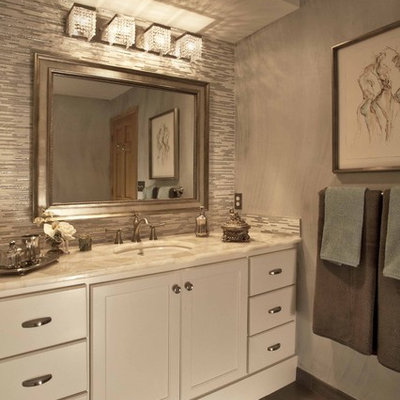 Inspiration for a timeless multicolored tile bathroom remodel in Minneapolis with an undermount sink, white cabinets and recessed-panel cabinets