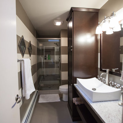 Small eclectic 3/4 multicolored tile and ceramic tile ceramic tile and gray floor alcove shower photo in Seattle with a vessel sink, flat-panel cabinets, dark wood cabinets, granite countertops, a two-piece toilet, multicolored walls, a hinged shower door and gray countertops