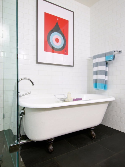 Example Of A Trendy Black Floor Claw Foot Bathtub Design In Toronto