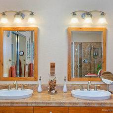 Tropical Bathroom by Remodel Works Bath & Kitchen