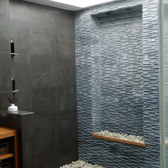 tropical bathroom by Essential Design Services