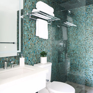 Inspiration for a beach style blue tile mosaic tile floor and gray floor bathroom remodel in San Diego with flat-panel cabinets, white cabinets, blue walls, an undermount sink and white countertops