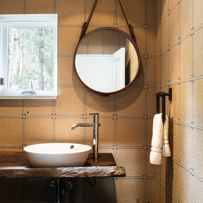 Small eclectic 3/4 bathroom photo in Sacramento with open cabinets, brown cabinets, brown walls and wood countertops