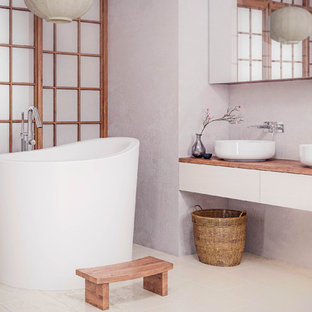 Inspiration for a small contemporary japanese bathtub remodel in Miami
