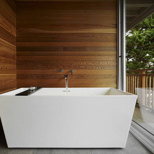 Example of a mid-sized minimalist master brown tile gray floor freestanding bathtub design in San Francisco with brown walls