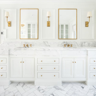 Elegant master white floor bathroom photo in Salt Lake City with recessed-panel cabinets, white cabinets, white walls, an undermount sink and white countertops