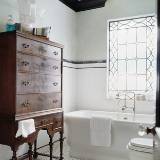 Photo of a victorian 3/4 bathroom in Other with a freestanding tub, white tile, subway tile, a shower/bathtub combo, a two-piece toilet, white walls, mosaic tile floors, multi-coloured floor and a shower curtain.