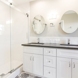 Small elegant master white tile and subway tile ceramic tile and gray floor bathroom photo in Other with shaker cabinets, white cabinets, a two-piece toilet, gray walls, an undermount sink, quartz countertops and gray countertops