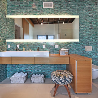 Inspiration for a contemporary bathroom remodel in Los Angeles with a wall-mount toilet