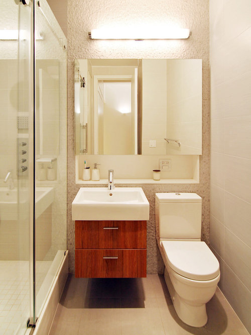 example of a small minimalist 34 bathroom design in new york with an alcove
